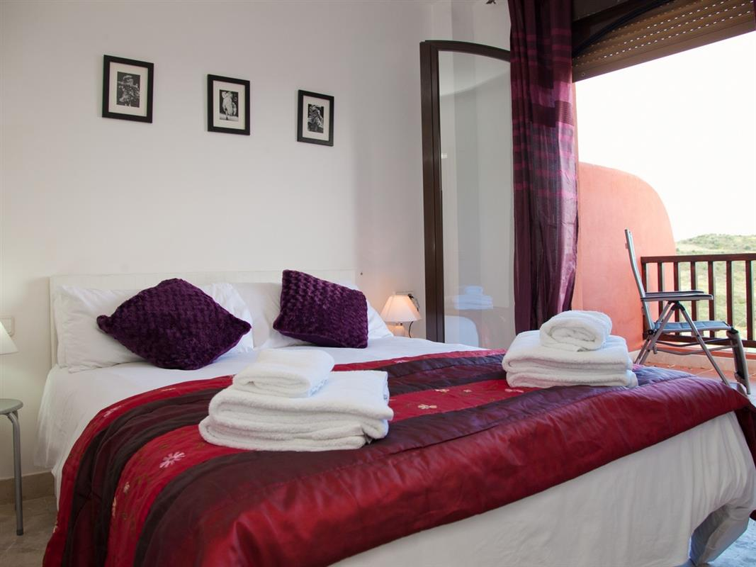 Holiday rental fantastic townhouse with air con wifi and pool costa galera estepona west Master bedroom with terrace