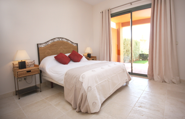 Holiday rental ground floor apartment with garden and heated pool benatalaya estepona east Master bedroom with terrace